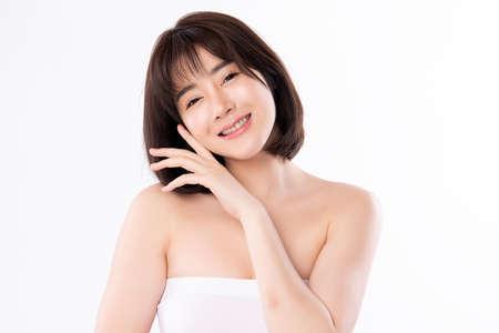 Foto de Beautiful Young asian Woman with Clean Fresh Skin, on white background, Face care, Facial treatment. Cosmetology, beauty and spa. Asian women portrait - Imagen libre de derechos