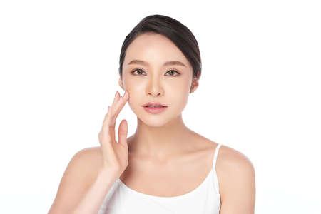 Foto de Beautiful young asian woman with clean fresh skin on white background, Face care, Facial treatment, Cosmetology, beauty and spa, Asian women portrait - Imagen libre de derechos