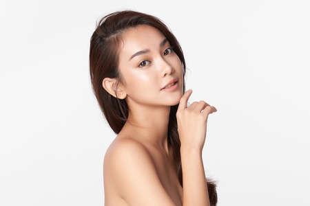 Foto de Beautiful young asian woman with clean fresh skin on white background, Face care, Facial treatment, Cosmetology, beauty and spa, Asian women portrait. - Imagen libre de derechos