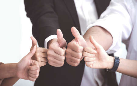 Photo pour Business People with thumb up after meeting about new normal planning at office - image libre de droit