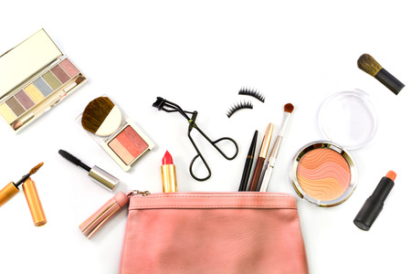 make up bag with cosmetics and brushes isolated on whiteの写真素材