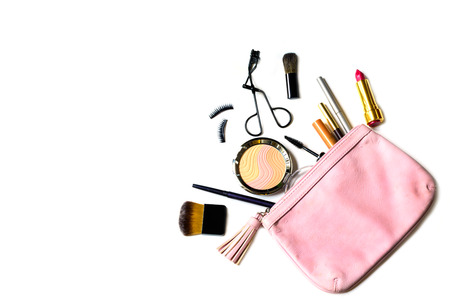 make up bag with cosmetics and brushes isolated on white backgroundの写真素材