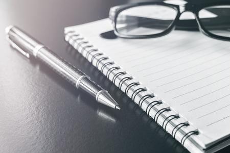 Photo pour notebook and pen on desk office, workplace, Monochrome tone - image libre de droit
