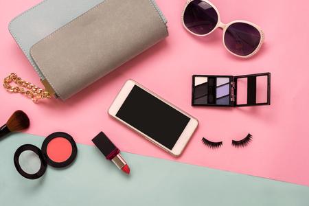 Photo pour Fashion woman essentials, cosmetics, cellphone, makeup accessories isolated on colorful background, Top view - image libre de droit