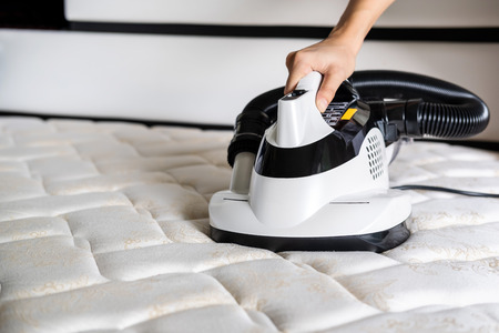 Photo for Mite vacuum cleaner Cleaning bed mattress dust eliminator - Royalty Free Image