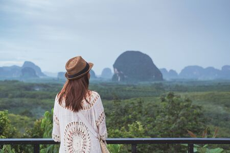 Photo for Young woman traveler looking at beautiful view - Royalty Free Image