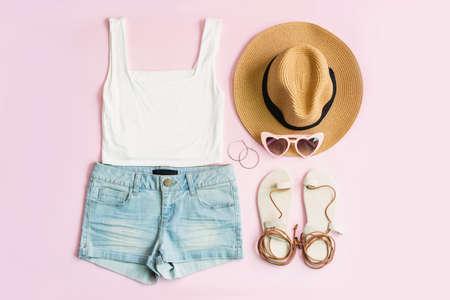 Photo pour Fashion summer women's clothes set with accessories on pink background, Flat lay, Top view - image libre de droit