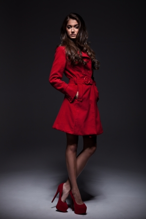 Young woman in a fashion coat
