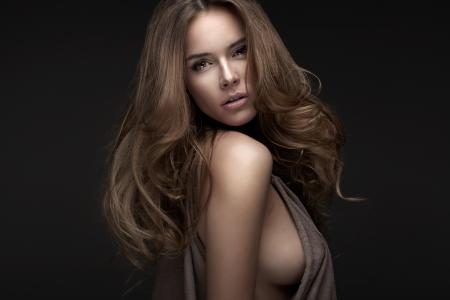 Photo pour Portrait of beautiful blonde woman on black background - image libre de droit