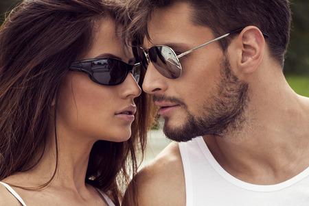 Portrait of sexy couple in sunglasses