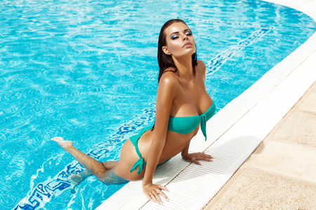 Sexy model in bikini in the pool
