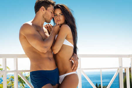 Photo for Sexy couple touching at each other outdoor in summer scenery - Royalty Free Image
