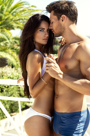 Foto de Sexy couple touching each other outdoor in summer scenery - Imagen libre de derechos
