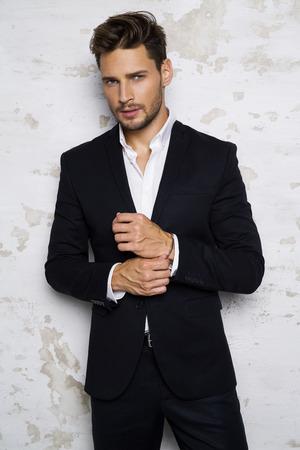 Foto de Portrait of sexy man in black suit - Imagen libre de derechos