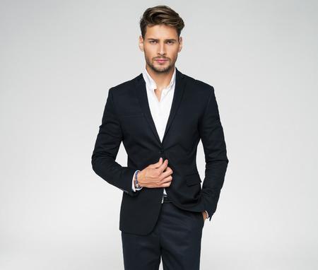 Photo pour Portrait of handsome man in black suit - image libre de droit