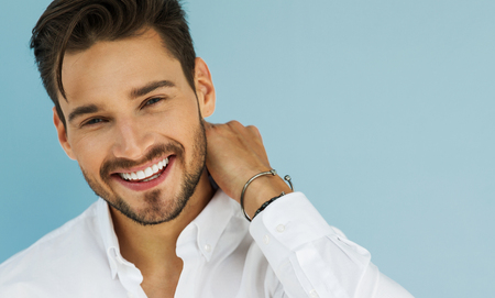 Photo pour Portrait of sexy smiling male model - image libre de droit