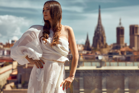 Photo pour Photo of young female model posing outdoor on urban scenery - image libre de droit
