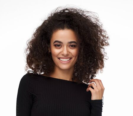 Photo pour Beautiful young woman with afro hairstyle wear fashionable clothes isolated on white background - image libre de droit