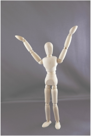 A dummy is holding his arms questioningly in the air