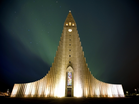 Northern lights  shining over the church in Reykjavik