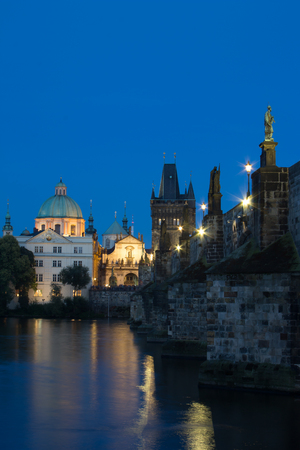 The church of Saint Francis of Assisi church during dusk blue hour. Old Town Tower of Charles bridge. Gothic bridge with baroque statues.の素材 [FY31085255153]