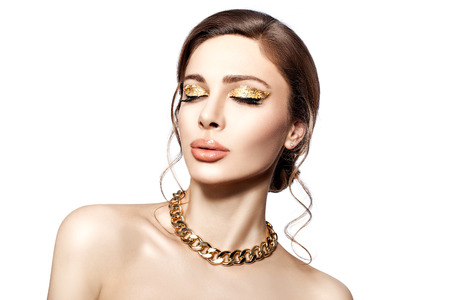 Beautiful portrait of a girl with big lips and gold on the eyelids