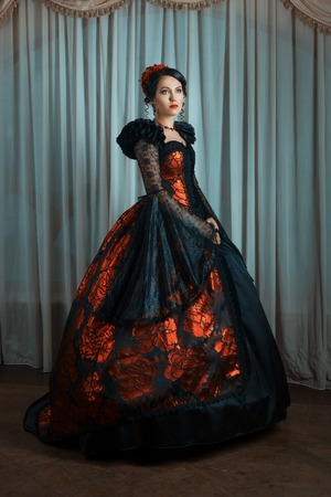 Renaissance Style - beautiful young woman in the lush expensive dress. Fashion. Vintage style.