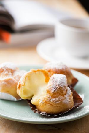 cream puff with vanilla stuff for coffee break