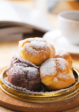 Choux cream with icing for coffee break