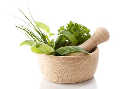 Healing herbs over white