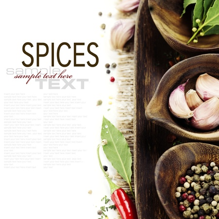 wooden bowls with fresh herbs and spices ( garlic, pepper, bay leaves) With sample text