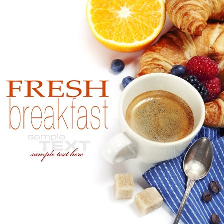 Delicious breakfast with fresh coffee, fresh croissants and fruits 