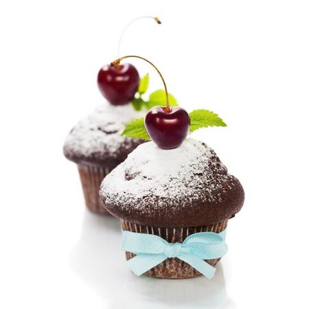 fresh chocolate muffins with cherry