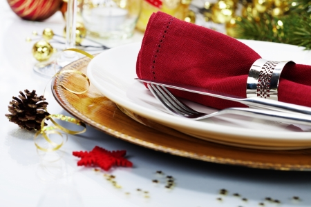 Christmas table place setting with christmas decorations