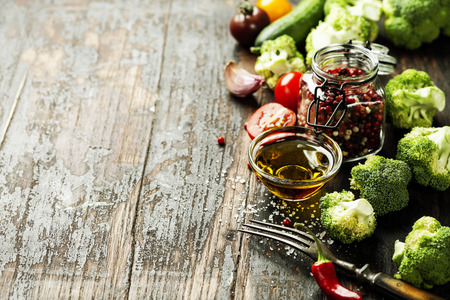 Fresh green broccoli and Healthy Organic Vegetables on a Wooden Background.