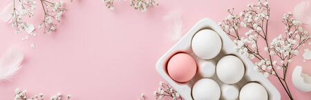Photo for Easter concept. Eggs in white ceramic holder and flowers on pink - Royalty Free Image
