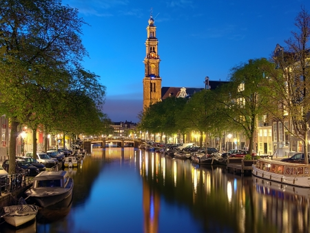 Evening view on the Westerkerk from Prinsengracht channel in Amsterdam, Netherlands