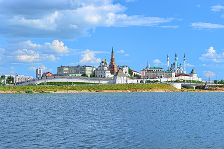 Kazan, Republic of Tatarstan, Russia. View of the Kazan Kremlin with Presidential Palace, Annunciation Cathedral, Soyembika Tower and Qolsharif Mosque from Kazanka River.