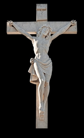 Statue of the crucifixion of Jesus isolated on black