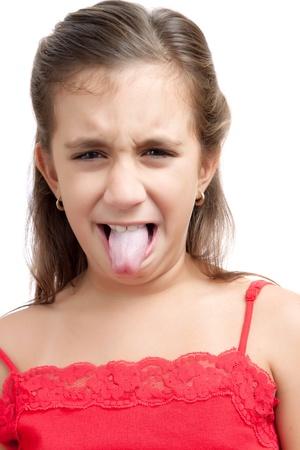 Hispanic girl making funny faces isolated on white