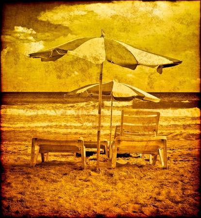 Vinatage postcard with umbrellas on a beach