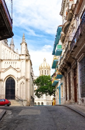 Street in Old Havana sidelined by a church and old typical buildings