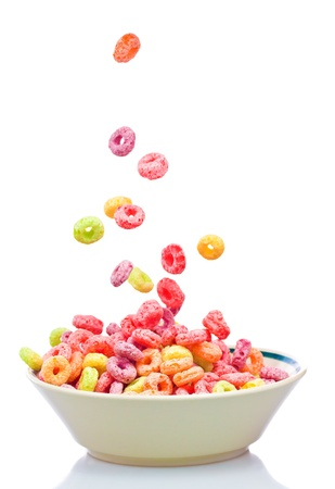 Colorful children's cereal falling into a bowl