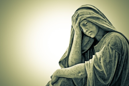 Vintage image of a suffering religious woman statue