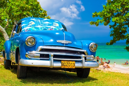 Classic car at a beach in Cuba