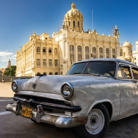 Vintage american car in front of the Museum of Revolution in Havana