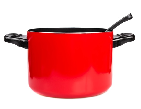 Metallic red cooking pot with a spoon isolated on a white background
