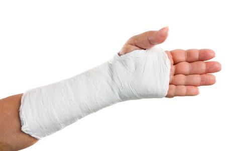 Photo pour Broken arm with a plaster cast isolated on white - image libre de droit