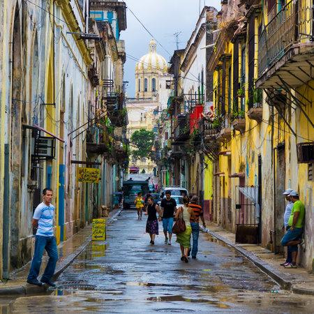 Cuban people in a typical old neighborhood in Havana
