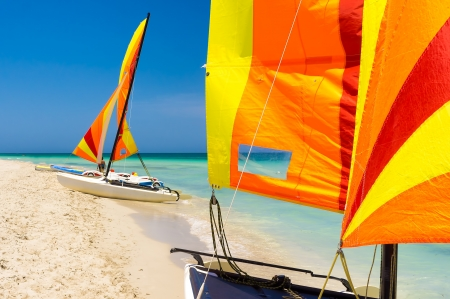Group of sailing boats and other nautical equipment on the sore of a beach in Cuba